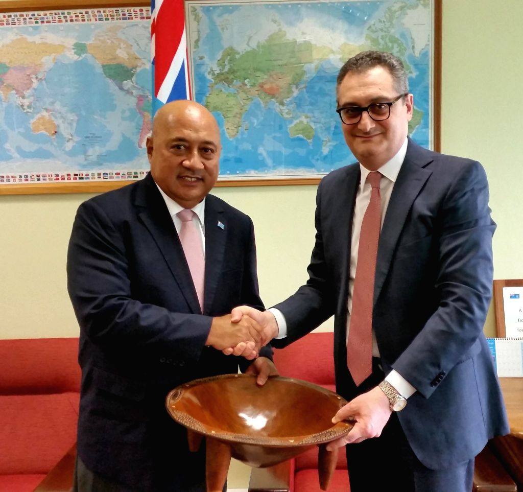 Fijian Foreign Minister Ratu Inoke Kubuabola (L) shakes hands with visiting Russian Deputy Foreign Minister Igor Morgulov and presents a wooden mixing bowl ... - Ratu Inoke Kubuabola