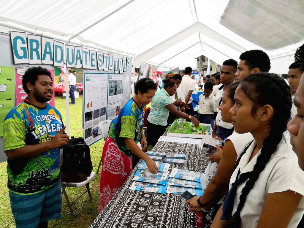 SUVA, July 26, 2019 - High school students listen as the staff members explain during the Open Day of the University of the South Pacific (USP) in Suva, capital of Fiji, July 26, 2019.