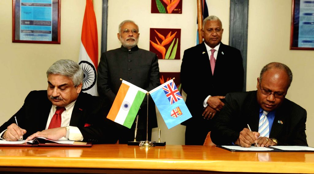 Prime Minister Narendra Modi and the Prime Minister of Fiji, Frank Bainimarama witness the signing of agreements between two countries, in Suva, Fiji on Nov 19, 2014. - Narendra Modi