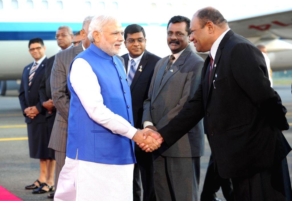 Prime Minister, Narendra Modi being received on his arrival, at Nausori International Airport, in Suva, Fiji on Nov 19, 2014. - Narendra Modi