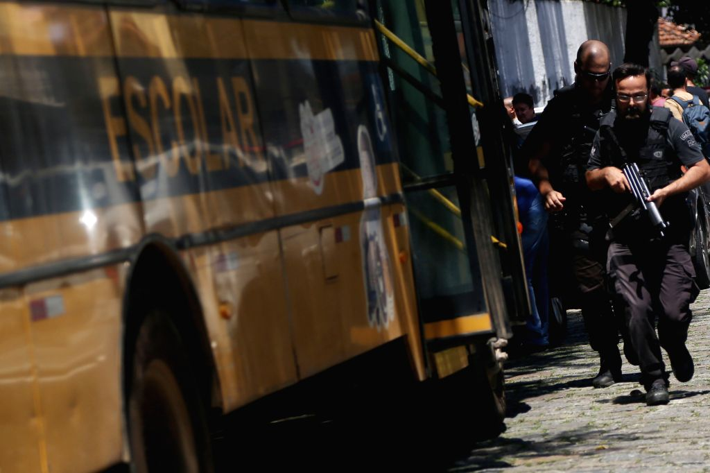SUZANO (BRAZIL), March 13, 2019 Policemen arrive at the school where a shooting occurred in Suzano city in the metropolitan region of Sao Paulo, Brazil, March 13, 2019. At least ten ...