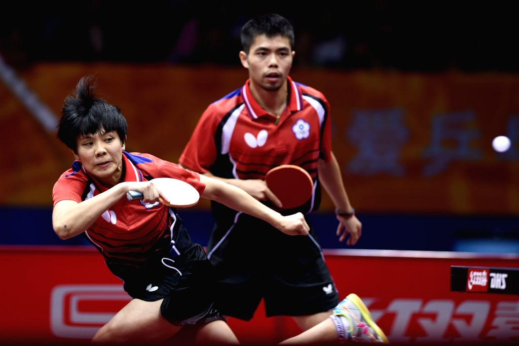 Chuang Chih-Yuan(R)/Cheng I-Ching of Chinese Taipei compete against Kalinikos Kreanga/Konstantinos Papageorgiou of Greece during Mixed Doubles match at the 53rd ...