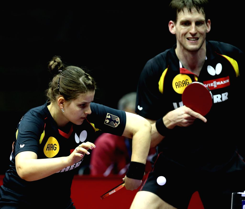 Germany's Steffen Mengel(R)/Petrissa Solja compete against Canada's Pierre-luc Theriault/Zhang Mo during Mixed Doubles match at the 53rd Table Tennis World ...