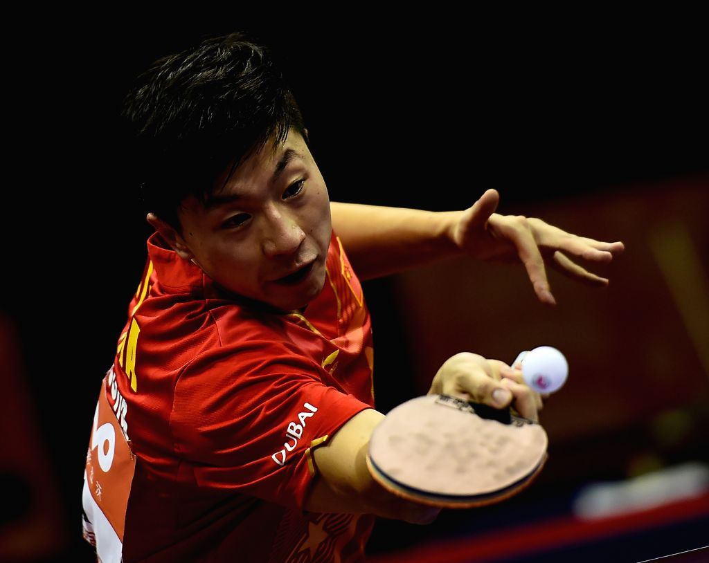 China's Ma Long competes against Iran's Noshad Alamiyan during Men's Singles match at the 53rd Table Tennis World Championships in Suzhou, city of east China's ...
