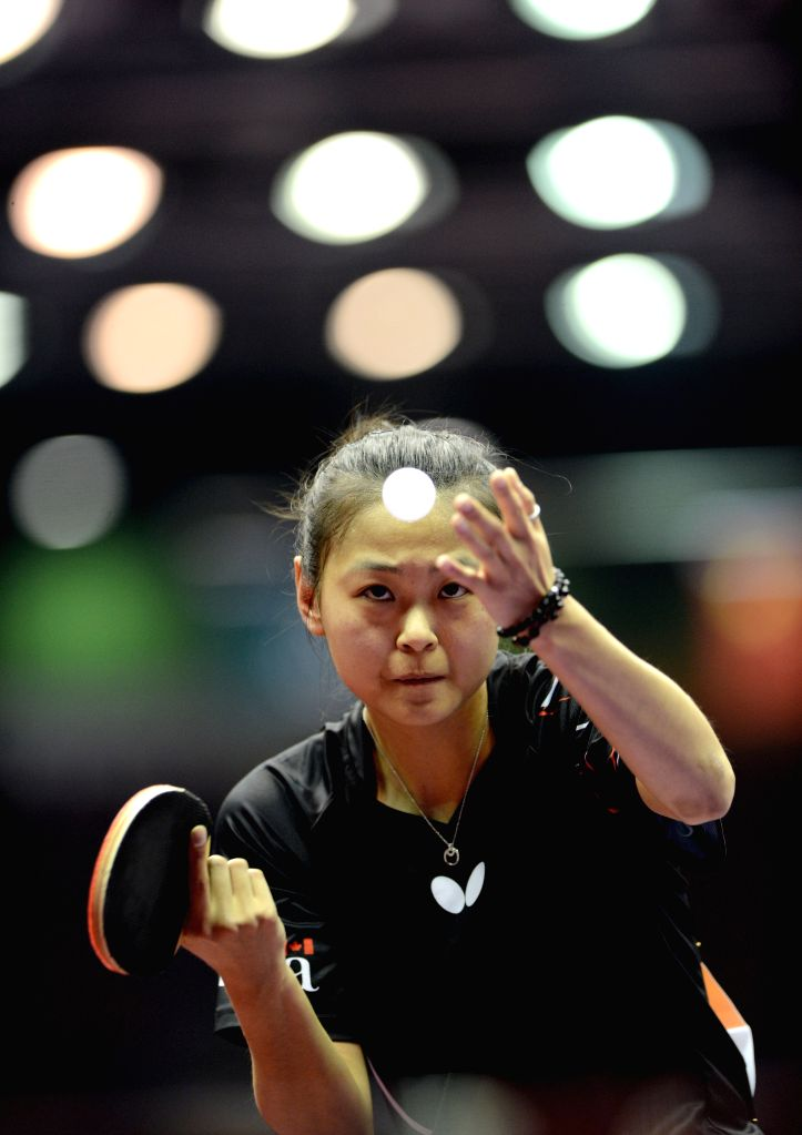 Canada's Zhang Mo competes against China's Li Xiaoxia during Women's Singles match at the 53rd Table Tennis World Championships in Suzhou, city of east China's ...