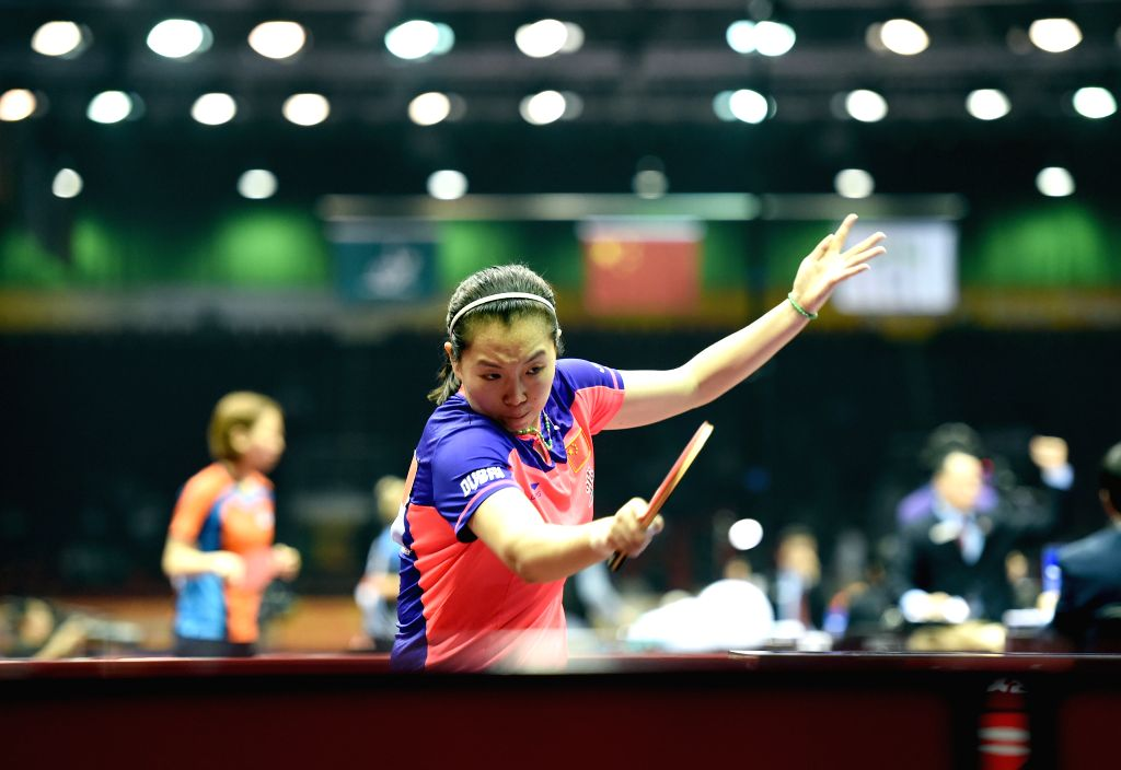 China's Li Xiaoxia competes agaisnt Canada's Zhang Mo during Women's Singles match at the 53rd Table Tennis World Championships in Suzhou, city of east China's ...