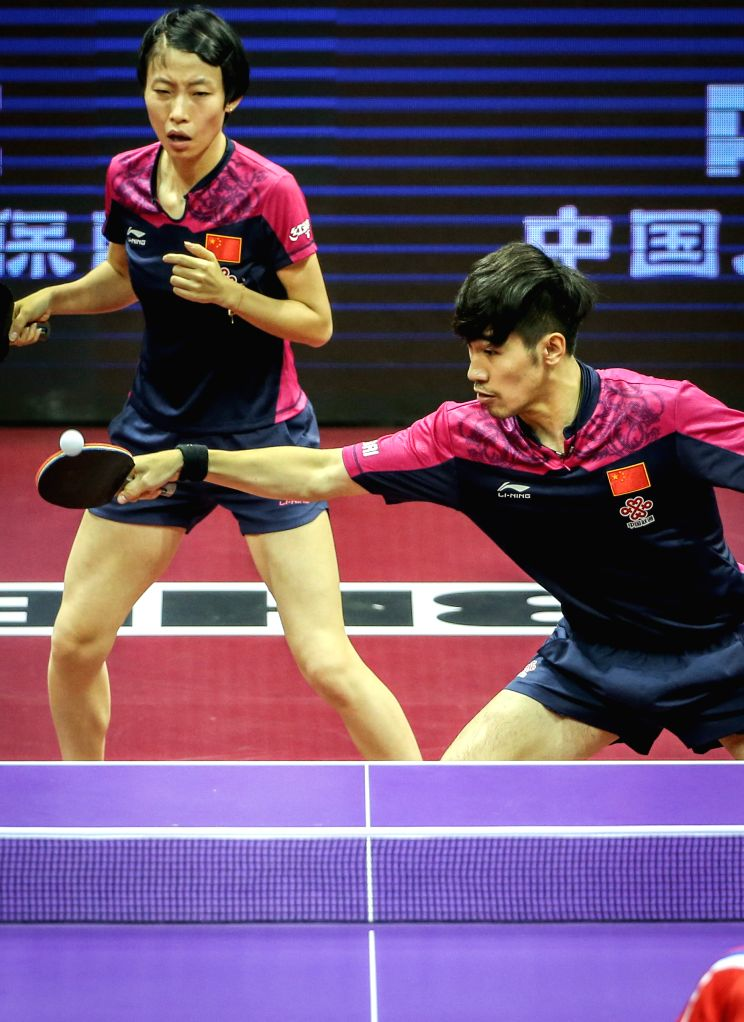 China's Yan An/Wu Yang(L) compete against Kim Hyok Bong/Kim Jong of the Democratic People's Republic of Korea (DPRK) during Mixed Doubles match at the 53rd Table ...