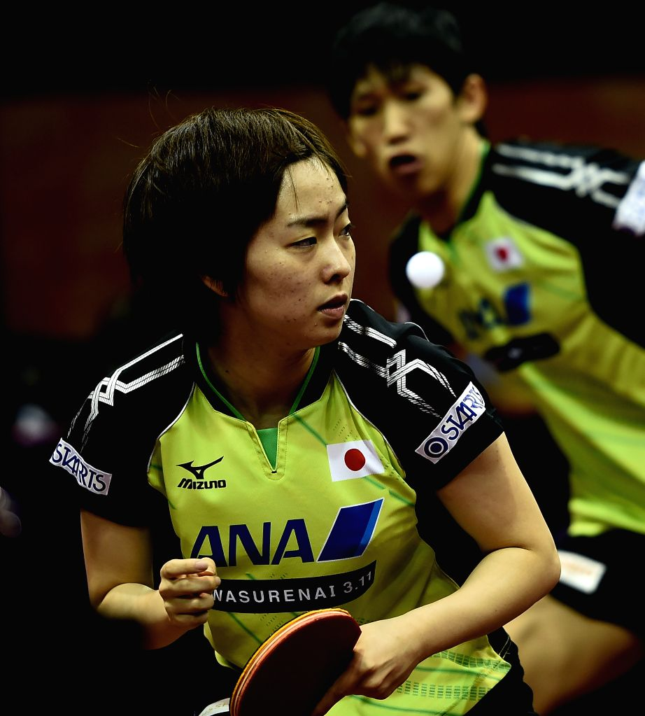 Japan's Yoshimura Maharu(Rear)/Ishikawa Kasumi compete against Pak Sin Hyok/Kim Hye Song of the Democratic People's Republic of Korea (DPRK) during Mixed Doubles ...
