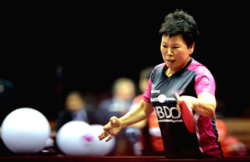 Luxemboueg's Ni Xialian competes during the Women's Singles match against Hong Kong China's Jiang Huajun at the 53rd Table Tennis World Championships in Suzhou, ...