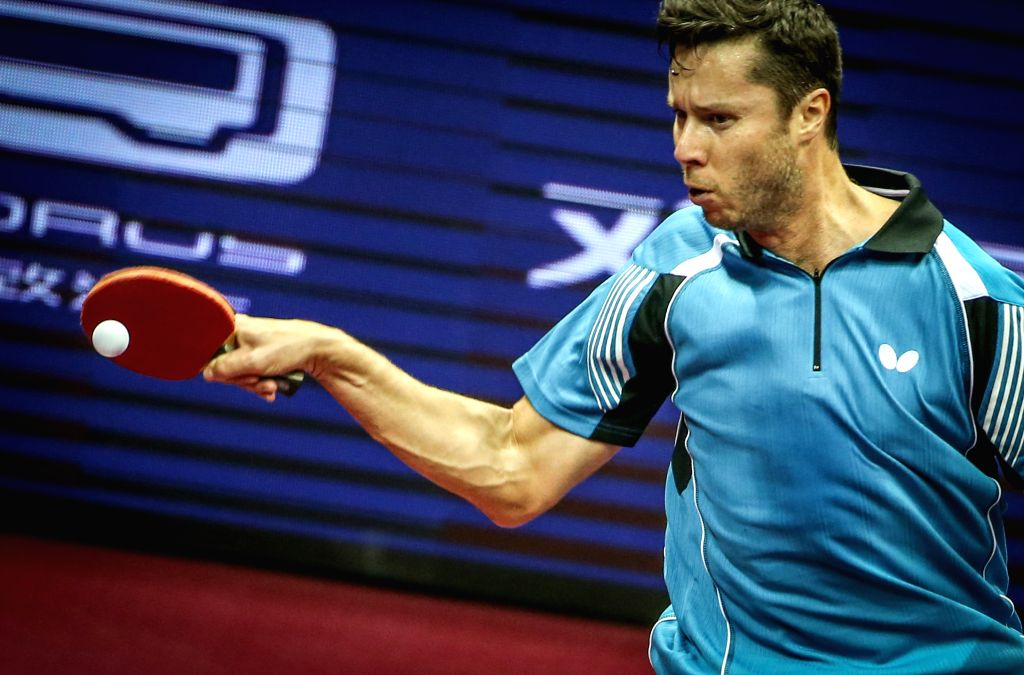 Belarus' Vladimir Samsonov competes against China's Zhang Jike during Men's Singles match at the 53rd Table Tennis World Championships in Suzhou, city of east China's ...