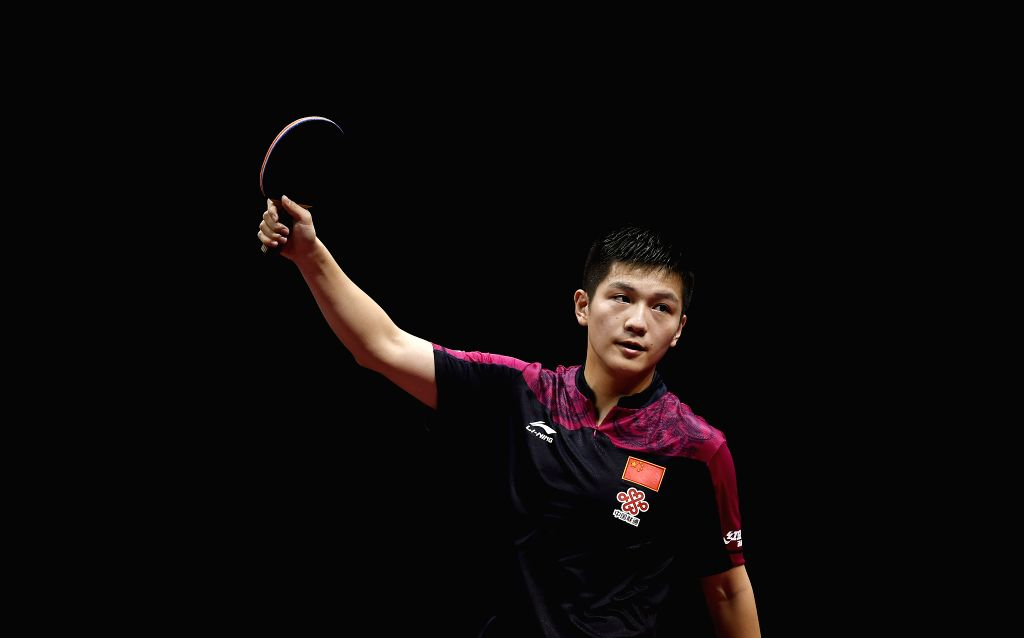 China's Fan Zhendong celebrates the victory after Men's Singles Quarterfinal against Germany's Timo Boll at the 53rd Table Tennis World Championships in Suzhou, city ...