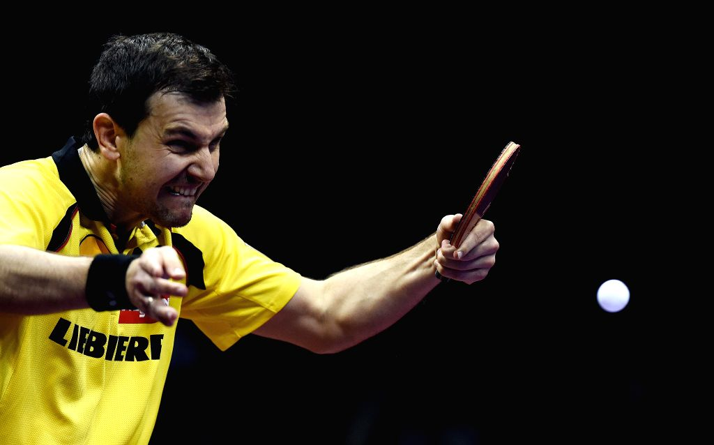 Germany's Timo Boll competes against China's Fan Zhendong during Men's Singles Quarterfinal at the 53rd Table Tennis World Championships in Suzhou, city of east ...