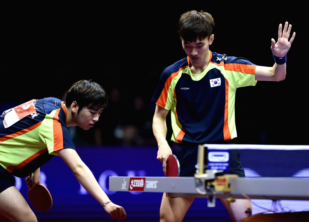 South Korea's Lee Sangsu/Seo Hyundeok(L) compete against China's Xu Xin/Zhang Jike during Men's Doubles Semifinal at the 53rd Table Tennis World Championships in ...