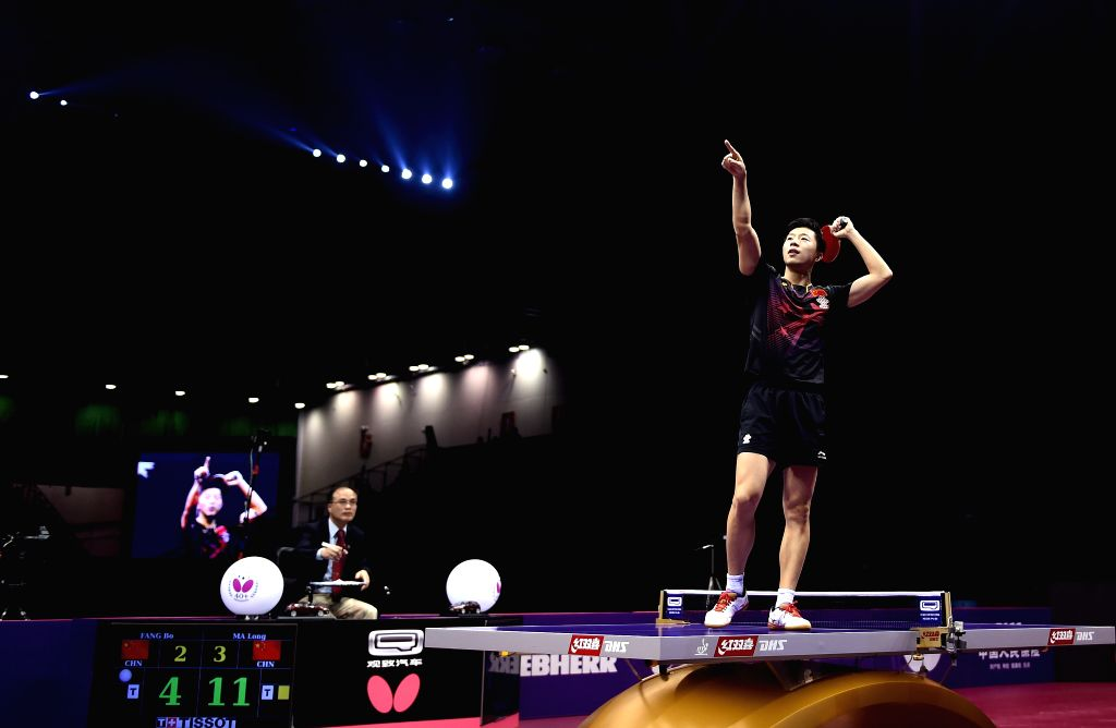 China's Ma Long celebrates the victory after Men's Singles Final against his compatriot Fang Bo at the 53rd Table Tennis World Championships in Suzhou, city of east ...