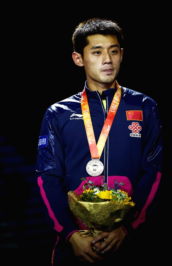China's Zhang Jike poses on the podium during the awarding ceremony for the Men's Singles Final match at the 53rd Table Tennis World Championships in Suzhou, city of ...