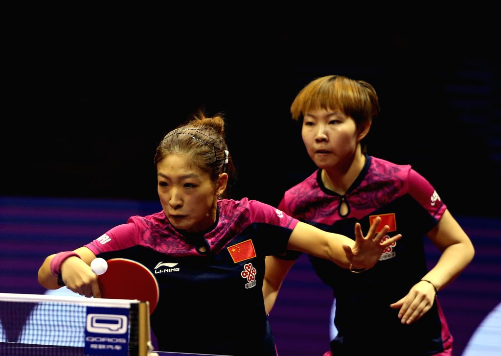 China's Zhu Yuling/Liu Shiwen(Front) compete against Singapore's Feng Tianwei/Yu Mengyu during Women's Doubles Semifinal at the 53rd Table Tennis World Championships ...