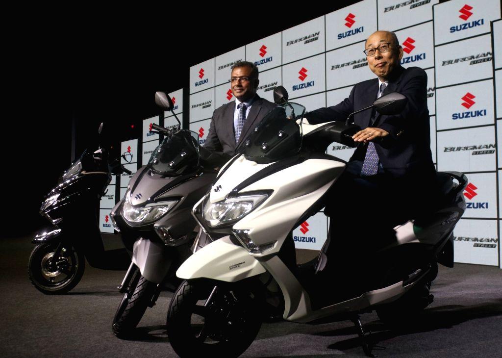 Suzuki Motorcycle India Limited (SMIPL) Managing Director  Satoshi Uchida, Executive Vice-President Sajeev Rajasekharan  at the launch of Suzuki Burgman Street 125CC Scooter, in New Delhi, ...