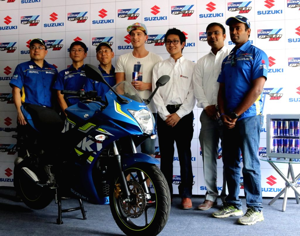 Suzuki Motorcycle India Private Limited (SMIPL) Managing Director Satoshi Uchida and Lithuanian stunt rider Aras Gibieza during a press conference at Ramjas College on 'Suzuki Gixxer Day' ...