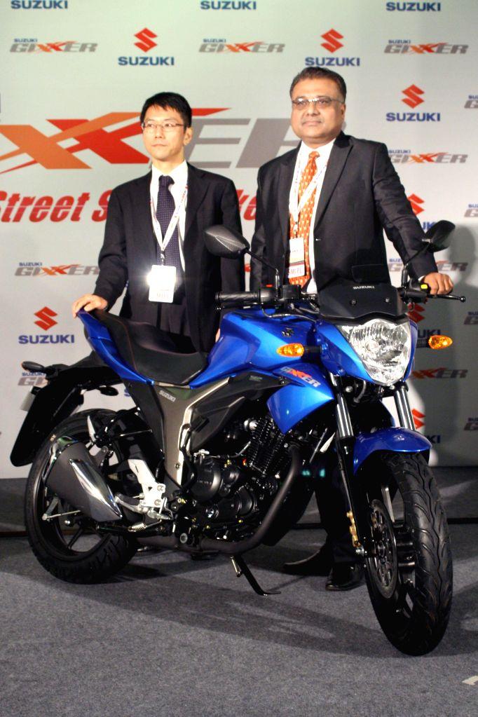 Suzuki Vice President Atul Gupta launches Suzuki 'GIXXER' in New Delhi on Sept 9, 2014. - Atul Gupta