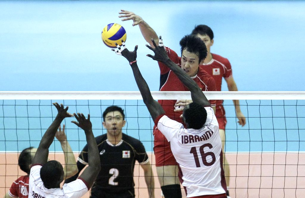 Suzuki Yoshifumi (top) of Japan spikes the ball during the match against Qatar at the 18th Asian Men's Volleyball Championship at Azadi Stadium in Tehran, Iran, on ...
