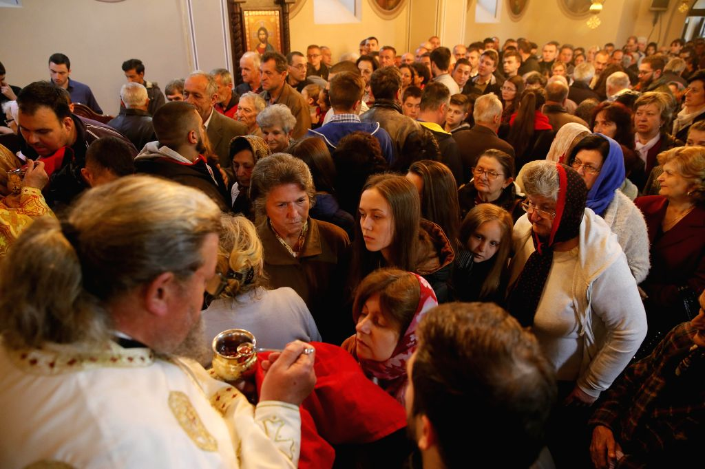 SVILAJNAC, April 16, 2017    Serbian orthodox people gather to receive communion, a Christian sacrament in which consecrated bread and wine are consumed as symbols for the realization of a ...