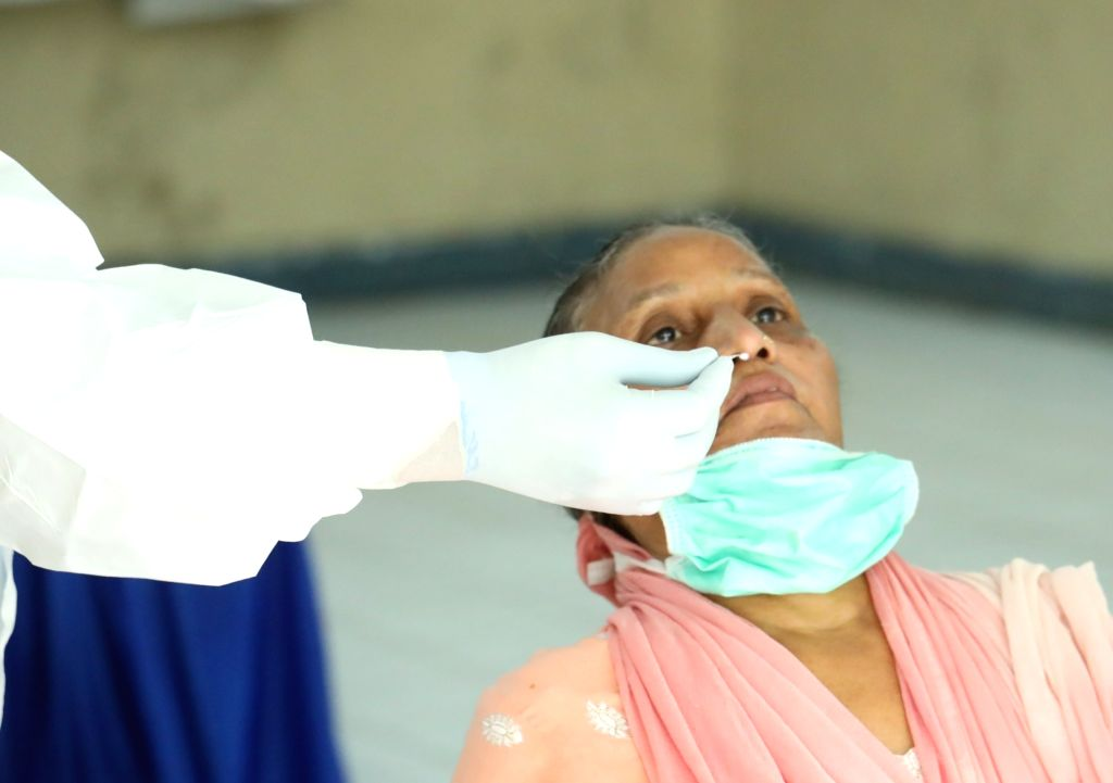 Swab samples being collected for COVID-19 testing at a coronavirus testing centre set up at a Government school in Delhi's Karol Bagh on June 23, 2020.