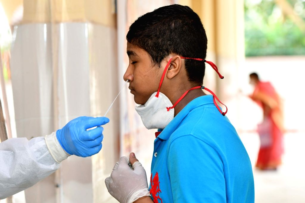 Swab samples being collected for COVID-19 testing at a coronavirus testing centre in New Delhi on June 24, 2020.