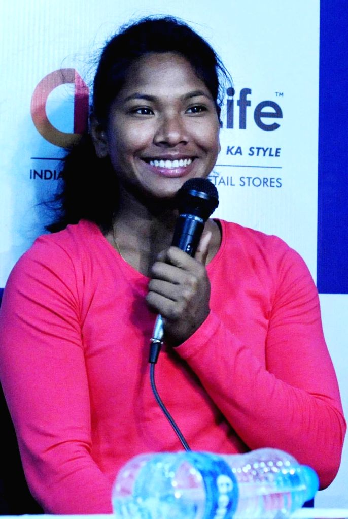 Swapna Barman, India's first-ever Asian Games gold medal winner in heptathlon addresses a press conference, in Kolkata on Sept 12, 2018.