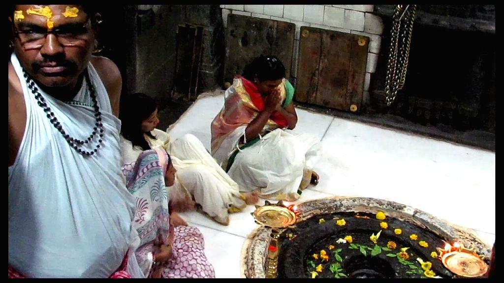Swaraj Mahila Sangathan leaders enter the sanctum sanctorum of Trimbakeshwar Temple - one of the 12 Jyotirlingas in Nashik of Maharashtra on April 21, 2016. Women have entered the temple for ...