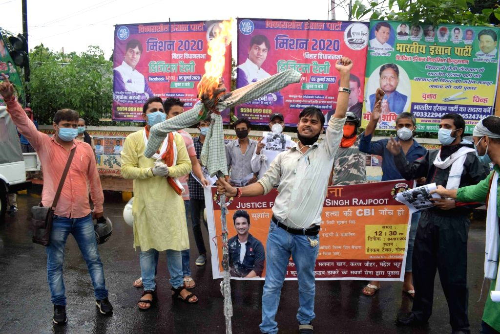 Swarna Sena activists burn an effigy of Bihar Chief Minister Nitish Kumar, demanding a CBI probe into the death of the late actor Sushant Singh Rajput, at Income Tax roundabout in Patna on ... - Nitish Kumar and Sushant Singh Rajput