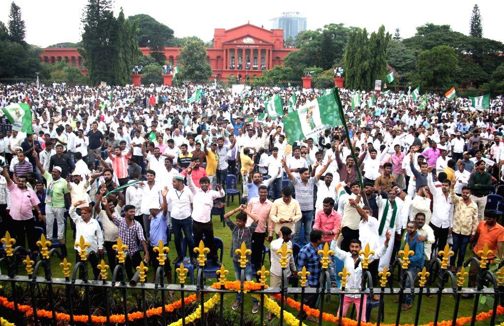 Swearing in ceremony of Karnataka Chief Minister H.D.Kumaraswamy underway at Vidhan Soudha in Bengaluru on May 23, 2018. - H.