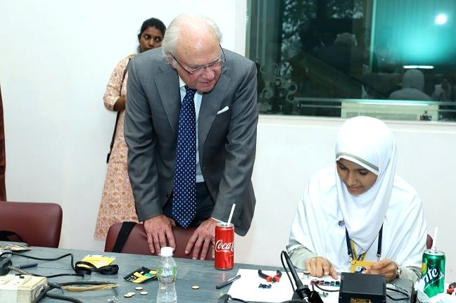 Sweden King Carl XVI Gustaf interactes with a student at a workshop on gender equality in education and workplace organised during Tekla Festival in Mumbai on Dec 5, 2019.