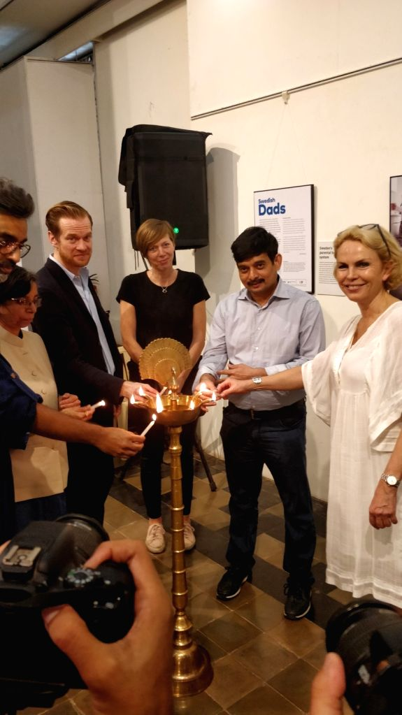 """Swedish Consul General in Mumbai Ulrika Sundberg and photographer Johan Bavman at the """"Swedish Dads - Indian Dads"""" a photo exhibition on gender sensitive parenthood to India, in ..."""