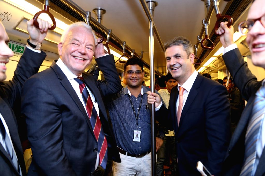Swedish Energy Minister Ibrahim Baylan and Sweden's Ambassador to India Harald Sandberg take a ride on Delhi Metro  in New Delhi, on Oct 8, 2016. - Ibrahim Baylan