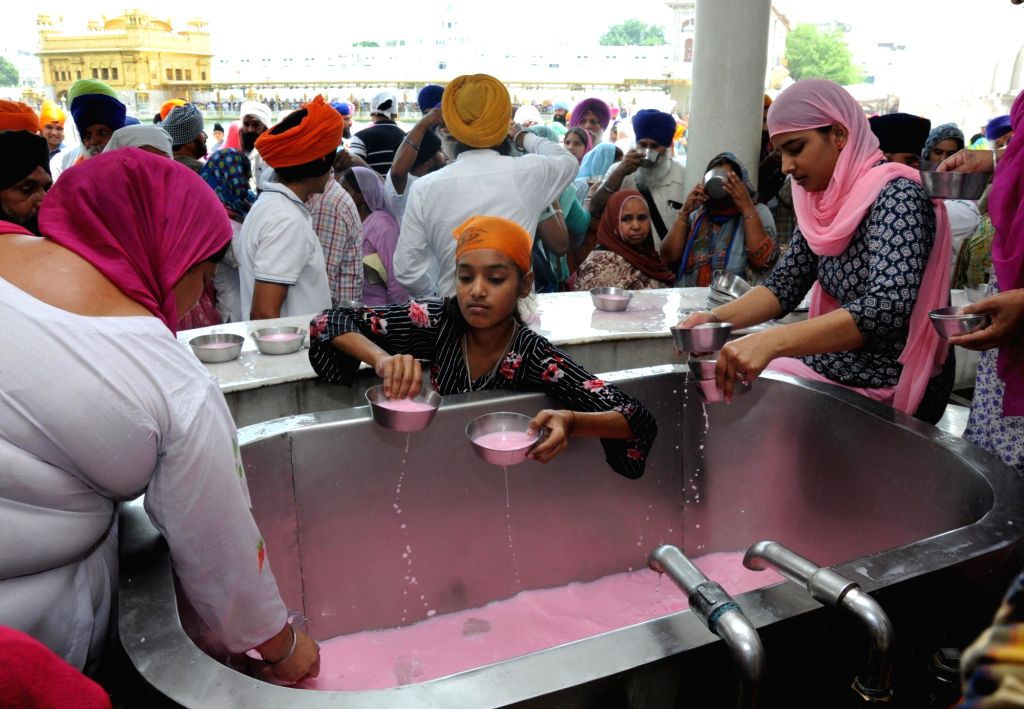 Sweetened water being prepared to be distributed among devotees on a hot sunny day at Golden Temple in Amritsar, on June 3, 2019.