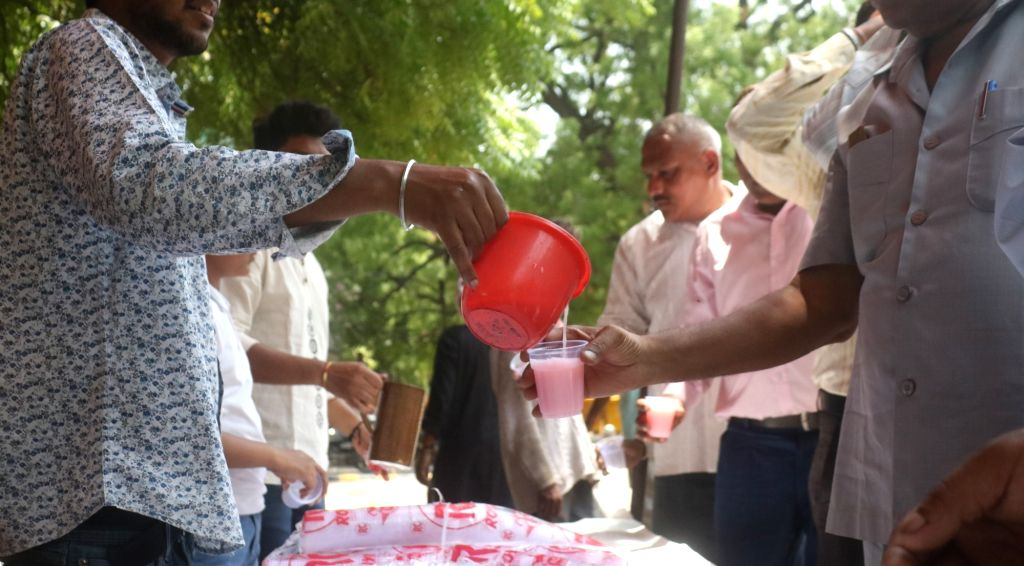 Sweetened water being served to the people on a hot summer day in New Delhi on June 13, 2019.