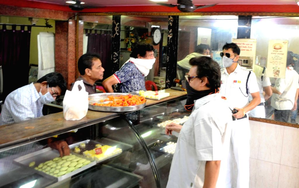 Sweetmeat shops operate between 12 noon to 4 pm on Day 7 of the 21-day nationwide lockdown imposed to contain the spread of coronavirus, in Kolkata on March 31, 2020.