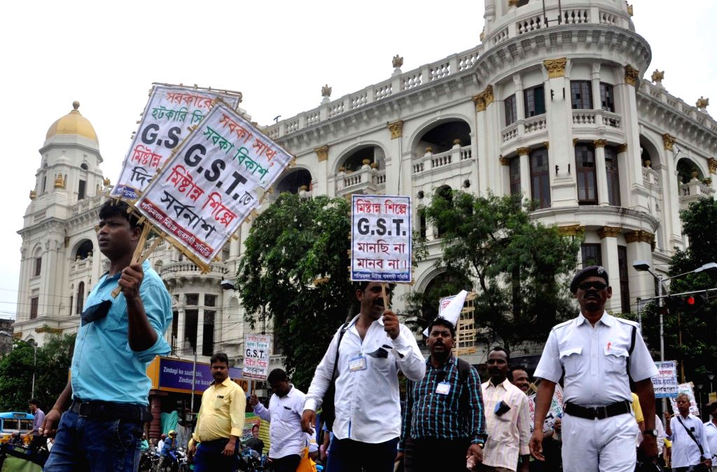 Sweetmeat traders stage a protest to press for removal of GST on sweets in Kolkata on July 25, 2017.