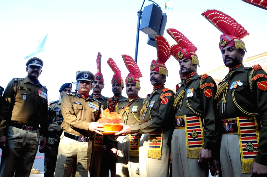 Sweets being distributes among BSF soldiers during the 71st Republic Day celebrations at Indo-Pak border at Attari, near Amritsar on Jan 26, 2020.