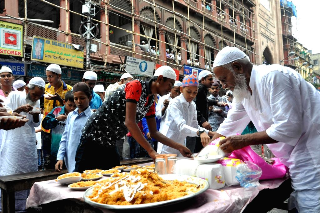 Sweets being offered after the namaz on the occasion of Eid-ul-Fitr at Nakhoda Masjid in Kolkata on June 26, 2017.