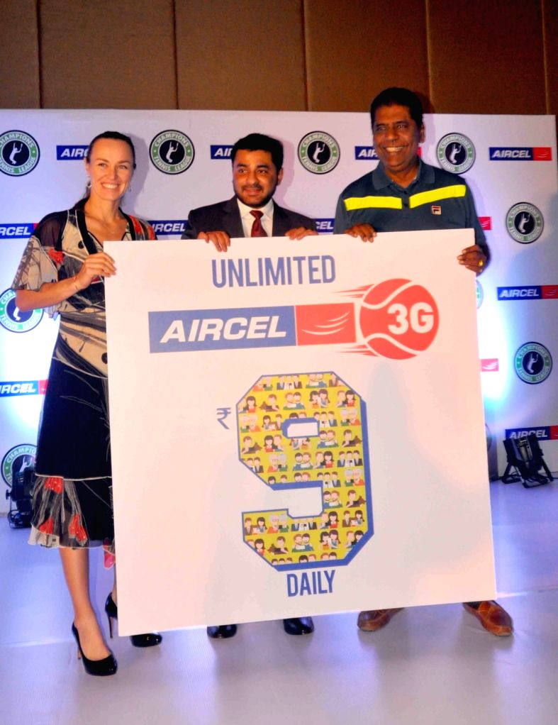 Swiss tennis player Martina Hingis, Aircel VP data and devices Sunil Kuttam and former Indian tennis player Vijay Amritraj during an Aircel programme organised in Hyderabad on Nov 30, ...
