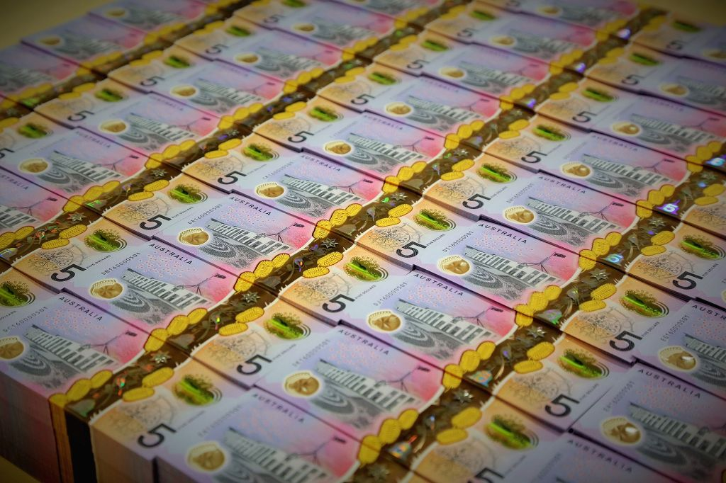 SYDNEY, April 12, 2016 - Photo provided by the Reserve Bank of Australia on April 12, 2016 shows stacks of the new five Australian dollar banknotes. The Reserve Bank of Australia (RBA) on Tuesday ...
