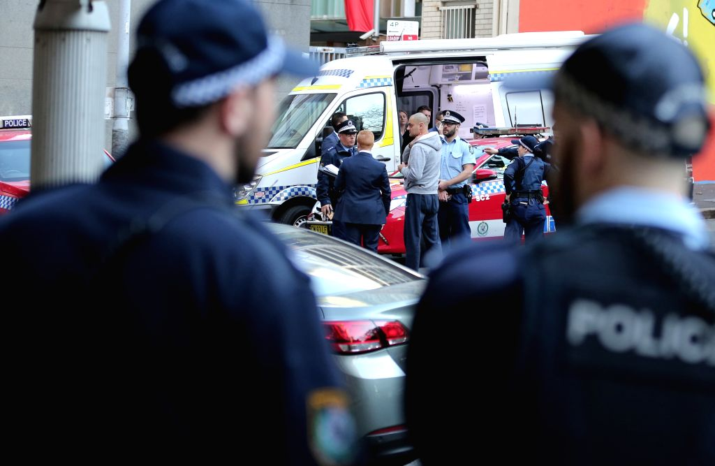 SYDNEY, Aug. 13, 2019 - Police officers are seen at the site of the knife attack in Sydney, Australia, Aug. 13, 2019. A woman was killed and at least two others were injured after a man brandishing a ...