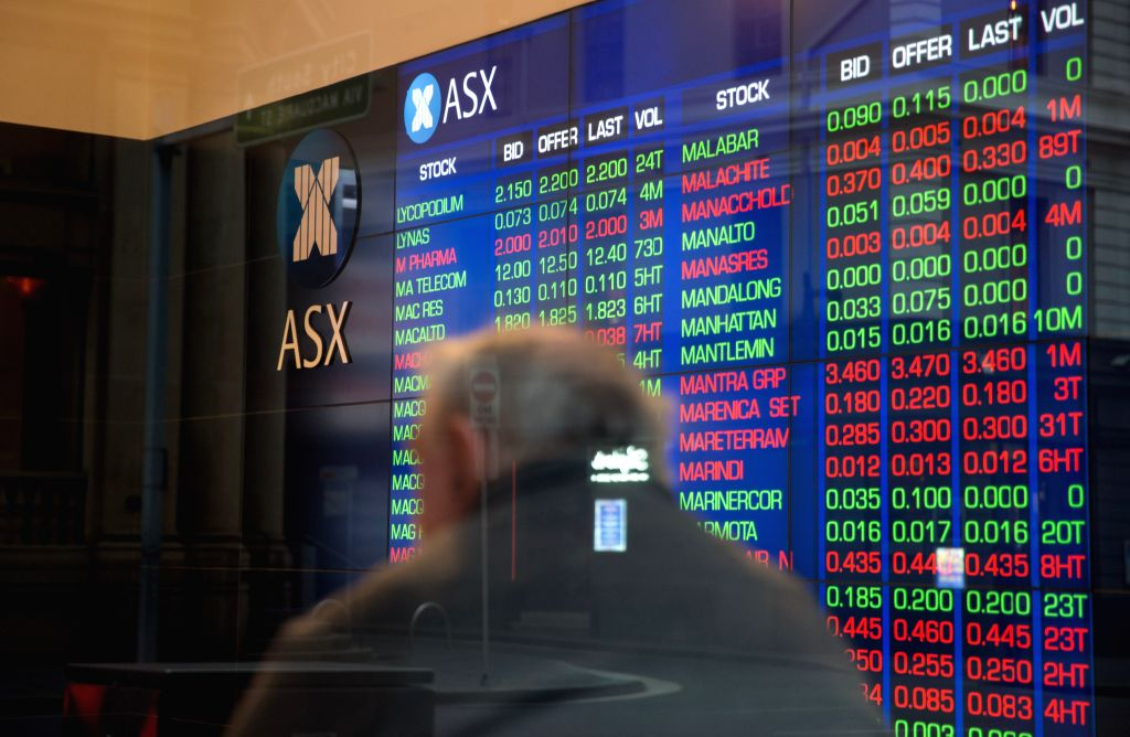SYDNEY, Aug. 2, 2016 - A man watches the board inside the Australian Securities Exchange Ltd's (ASX) in Sydney, Australia, Aug. 2, 2016. Australia's central bank has cut the official cash rate to a ...