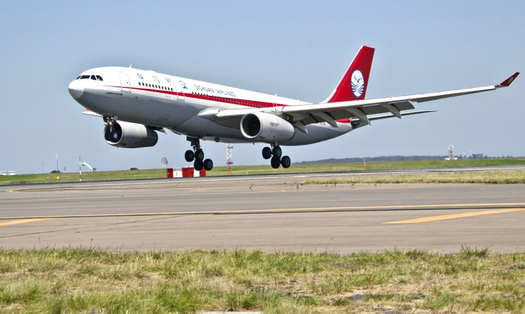 An Airbus A330 plane of China's Sichuan Airlines touches down at the Sydney Airport, Sydney, Australia, Dec. 20, 2013. A Sichuan Airlines A330 passenger ...