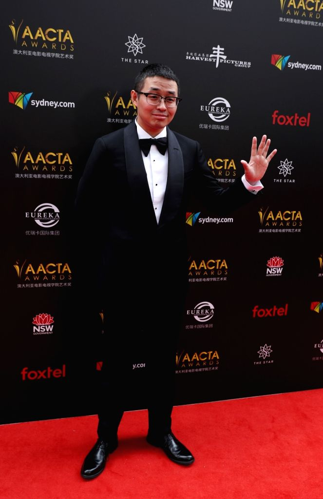 """SYDNEY, Dec. 5, 2018 - Wen Muye, director of the Chinese film """"Dying to Survive"""", poses for photos on the red carpet of the Australian Academy of Cinema and Television Arts (AACTA) awarding ..."""