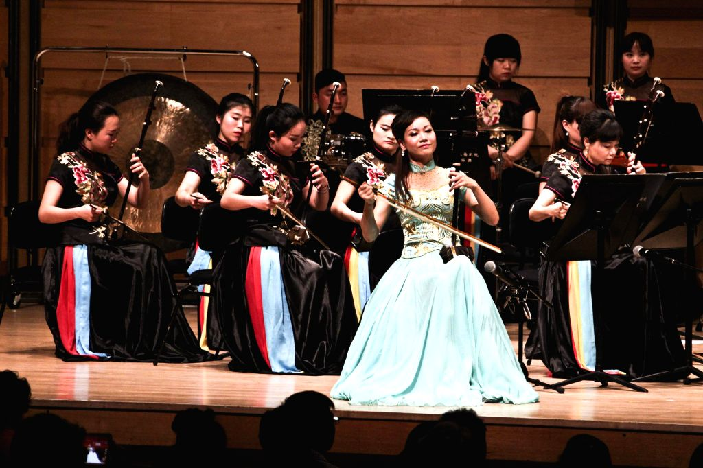 Chinese musicians perform during a traditional Chinese music concert to celebrate Chinese New Year in a Chinese cultural center in Sydney, Australia, Feb. 20, 2015. ...