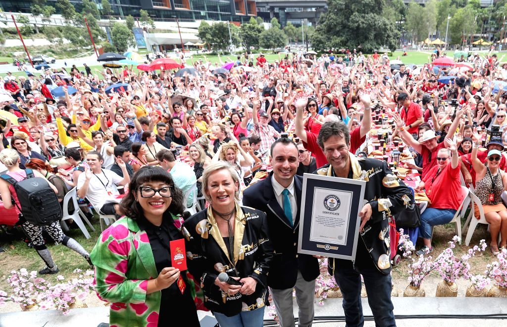 SYDNEY, Feb. 5, 2019 - Hosts and a representative from the Guinness World Records display a certificate during an event to set the largest serving of Dim Sum, at Tumbalong Park of Darling Harbour, ...