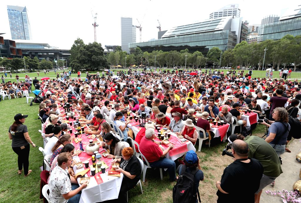 SYDNEY, Feb. 5, 2019 - People participate in an event to set a Guinness World Record for the largest serving of Dim Sum, at Tumbalong Park of Darling Harbour, Sydney, Australia, on Feb. 5, 2019.