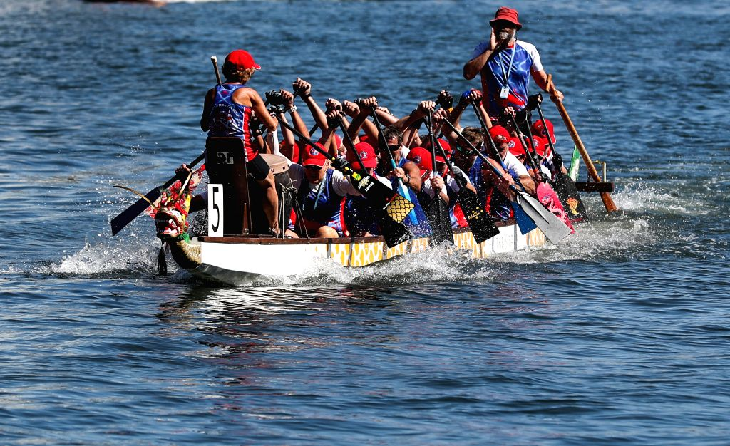 SYDNEY, Feb. 9, 2019 - Members of local dragon boat club compete during a dragon boat race at Darling Harbor, Sydney, Australia, Feb. 9, 2019. A dragon boat race is held at Darling Harbor to ...